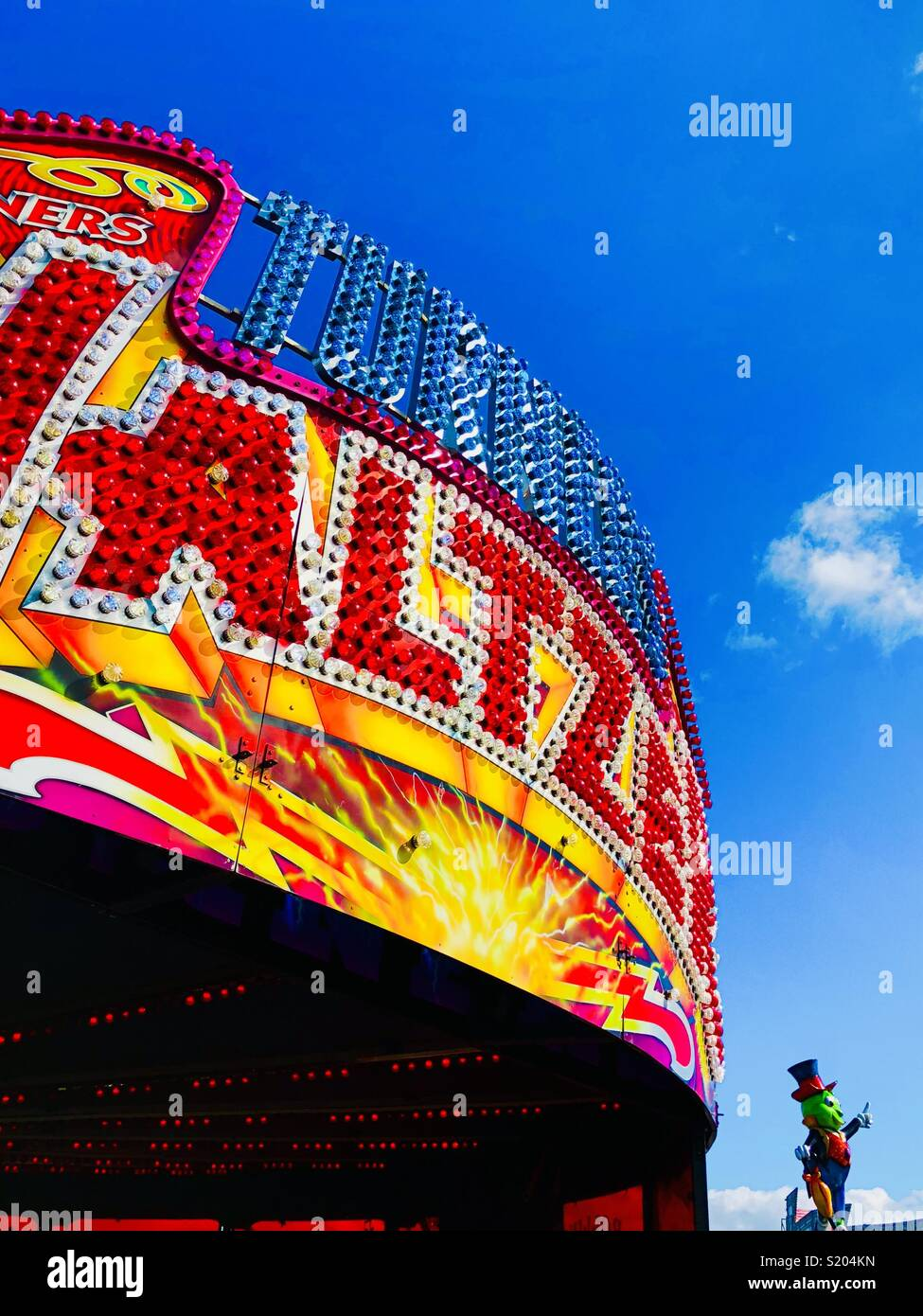 Fairground and blue sky in Whitley Bay, UK - Stock Image