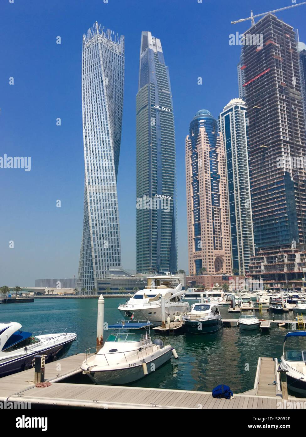 Dubai Marina with Cayan Tower in U.A.E. - Stock Image