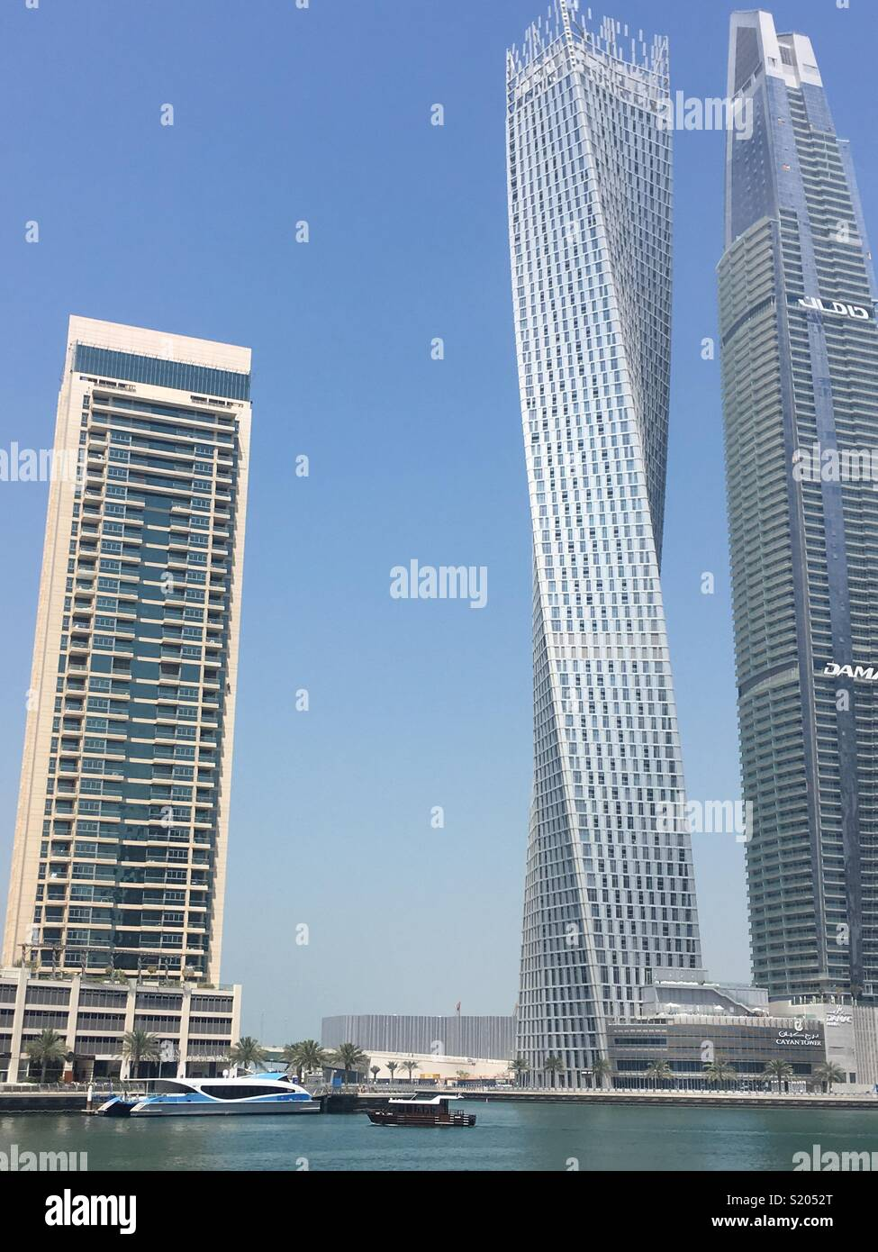 Cayan Tower the twisted building in Dubai. U.A.E. - Stock Image