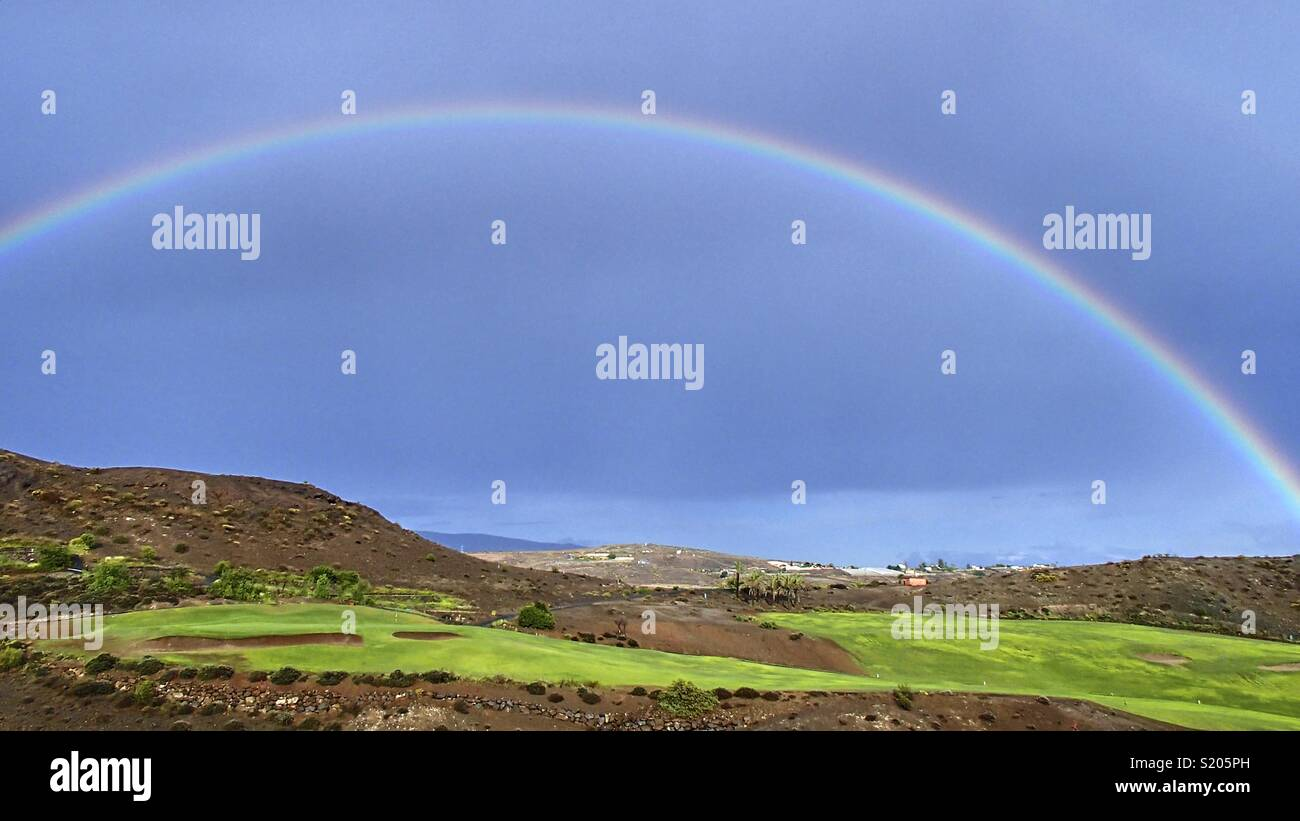 A Wonderful Colorful Rainbow In The Blue Sky Over A Green Golf Course On The Spanish Atlantic Island Of Gran Canaria Stock Photo Alamy