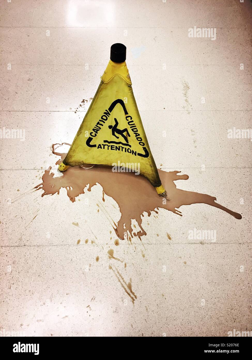Slippery surface warning sign was placed after some liquid was spilled  on the floor. - Stock Image