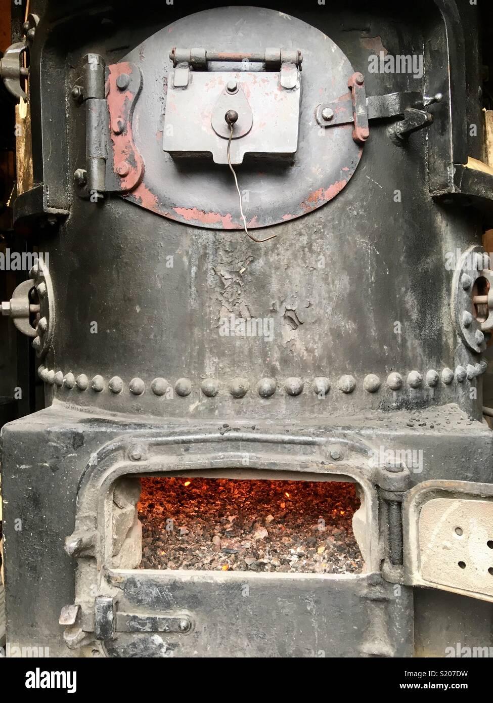 Old boiler with furnace door open & Old boiler with furnace door open Stock Photo: 311021813 - Alamy