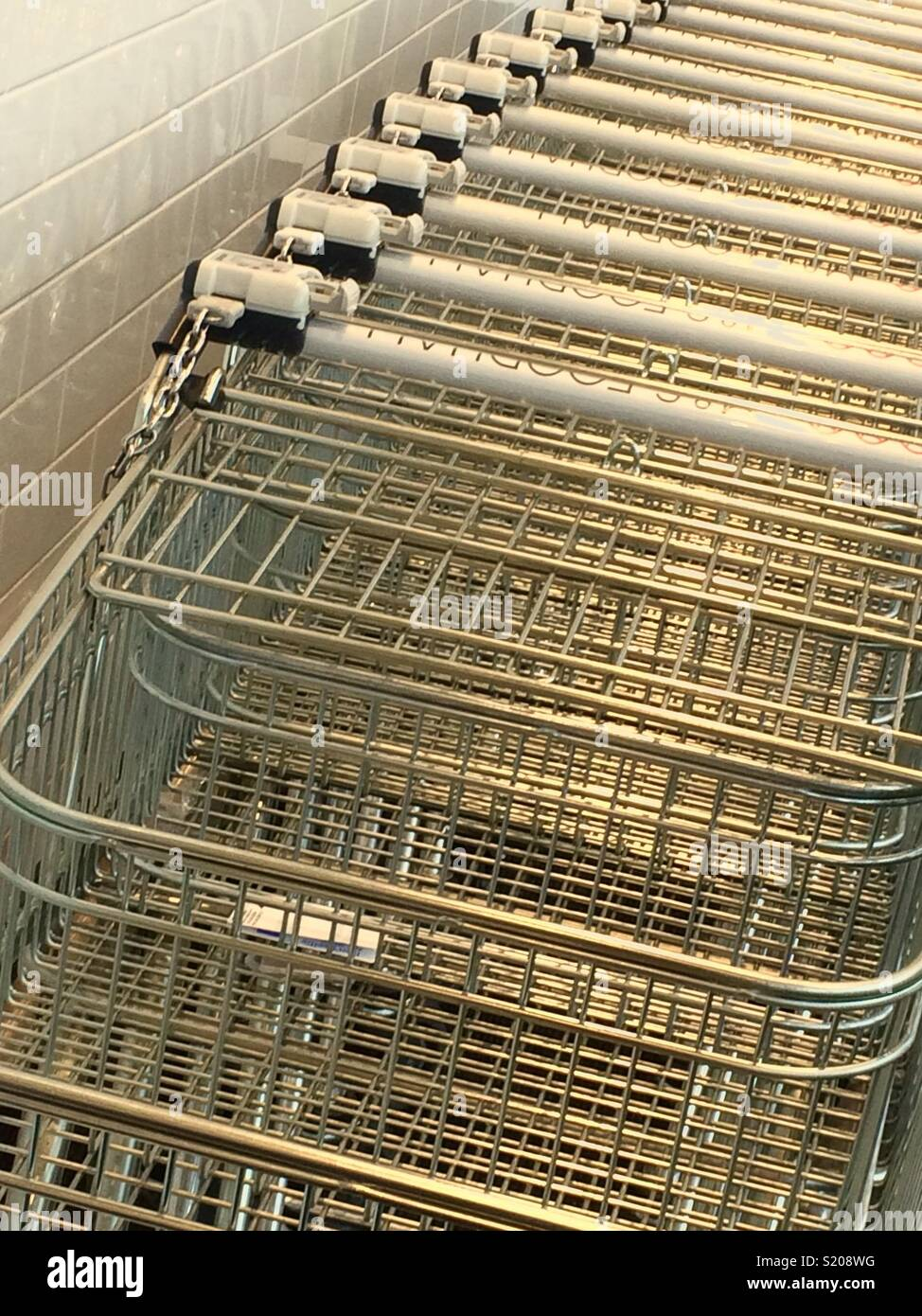 Empty Shopping trolleys at M&S foodhall - Stock Image