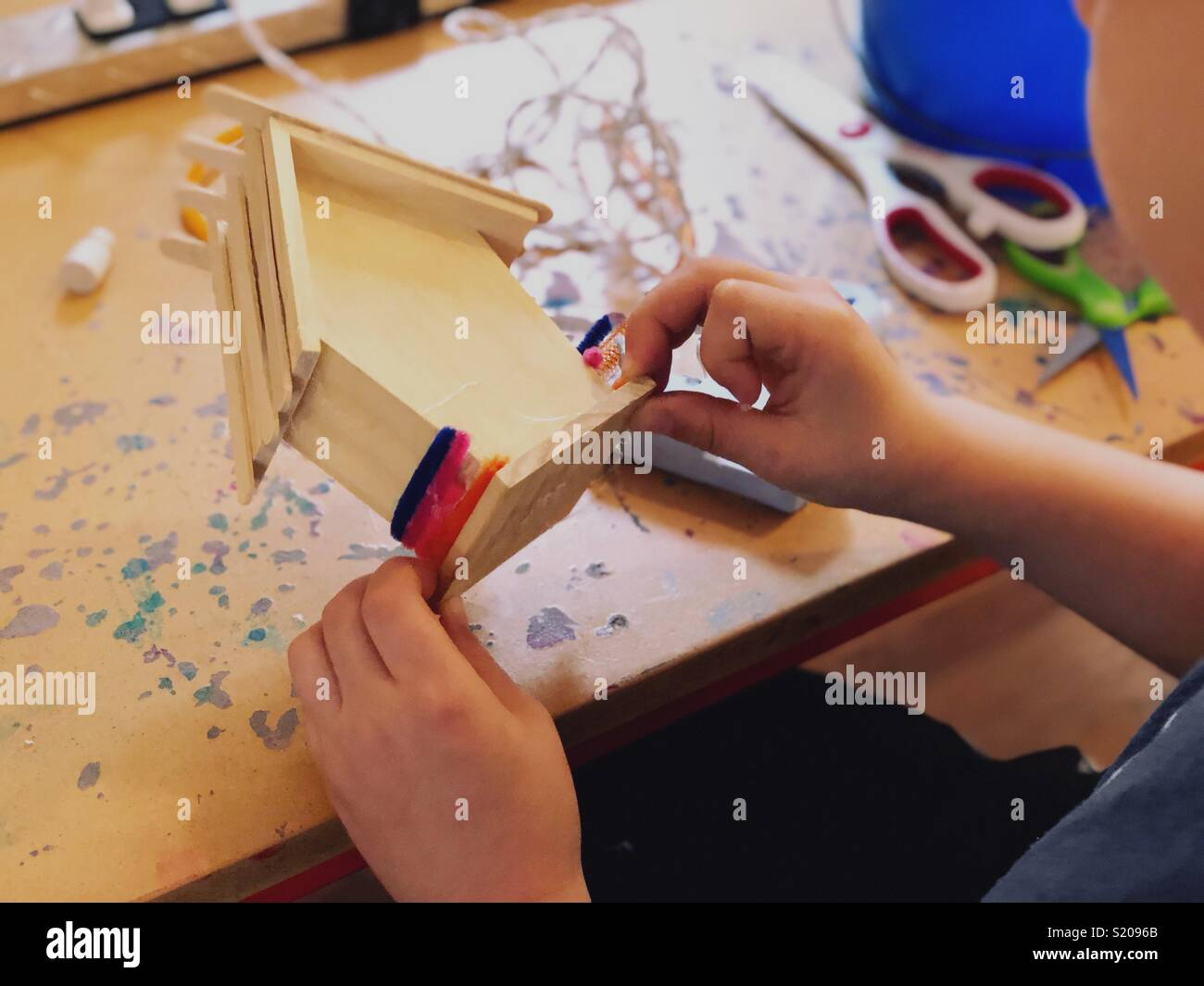 Boy crafting focus on hands - Stock Image