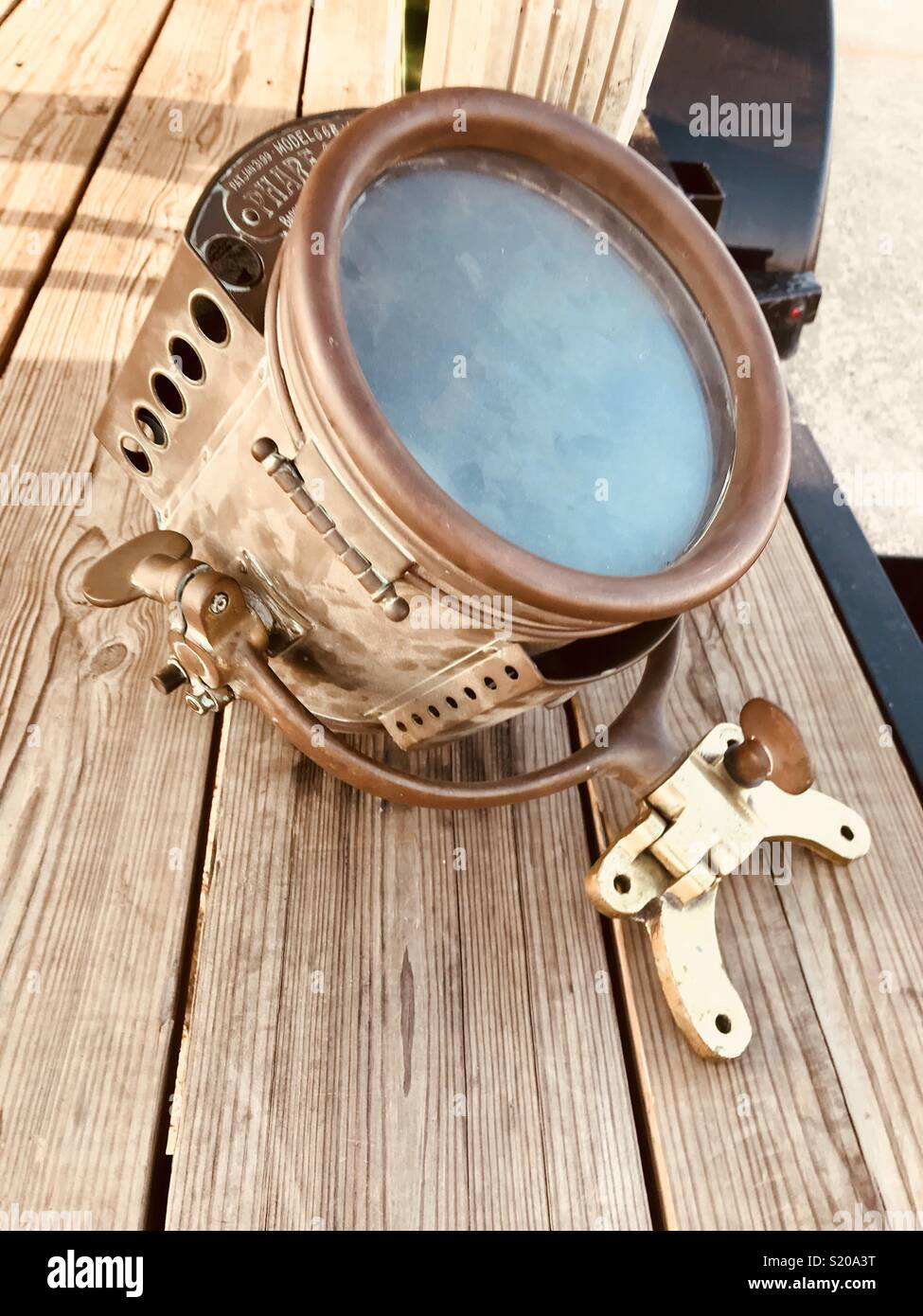 APRIL 14, 2018 - BAKERSFIELD, CA UNITED STATES: Antique horseless carriage headlamp on wood. - Stock Image