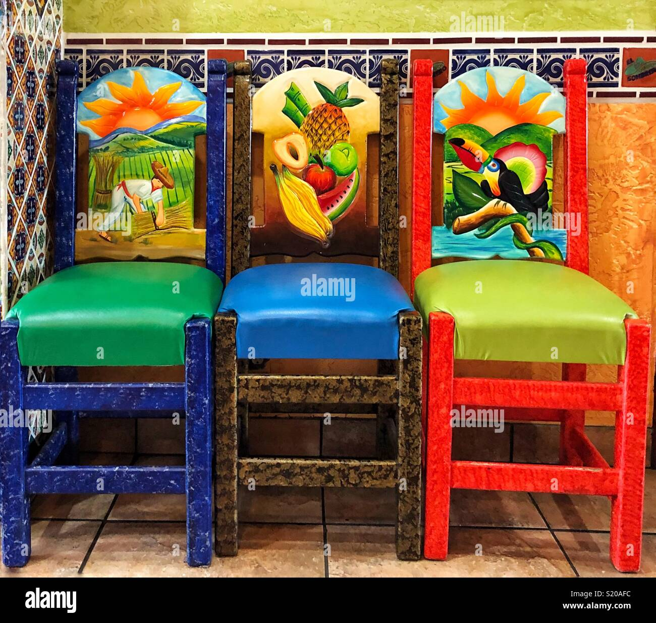 Three chairs Hand carved and painted in Mexican restaurant & Three chairs Hand carved and painted in Mexican restaurant Stock ...