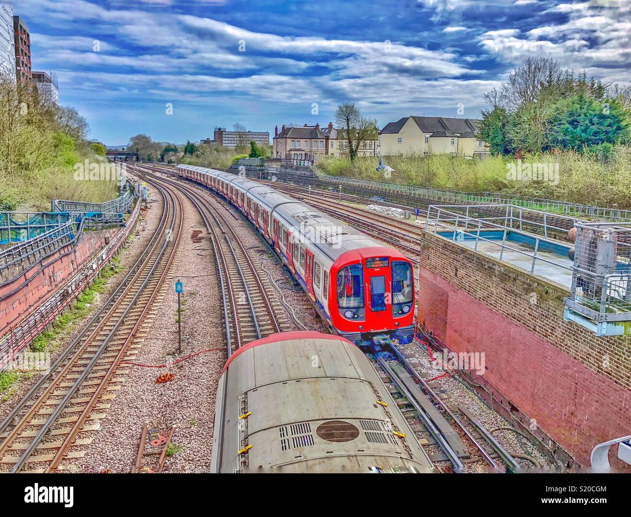London Underground trains passing by each other in west London. - Stock Image