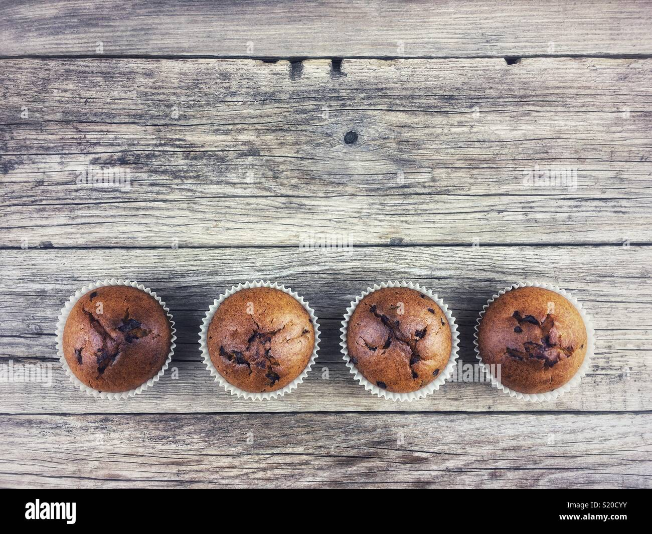 Top view of Chocolate muffins on a wooden table Stock Photo