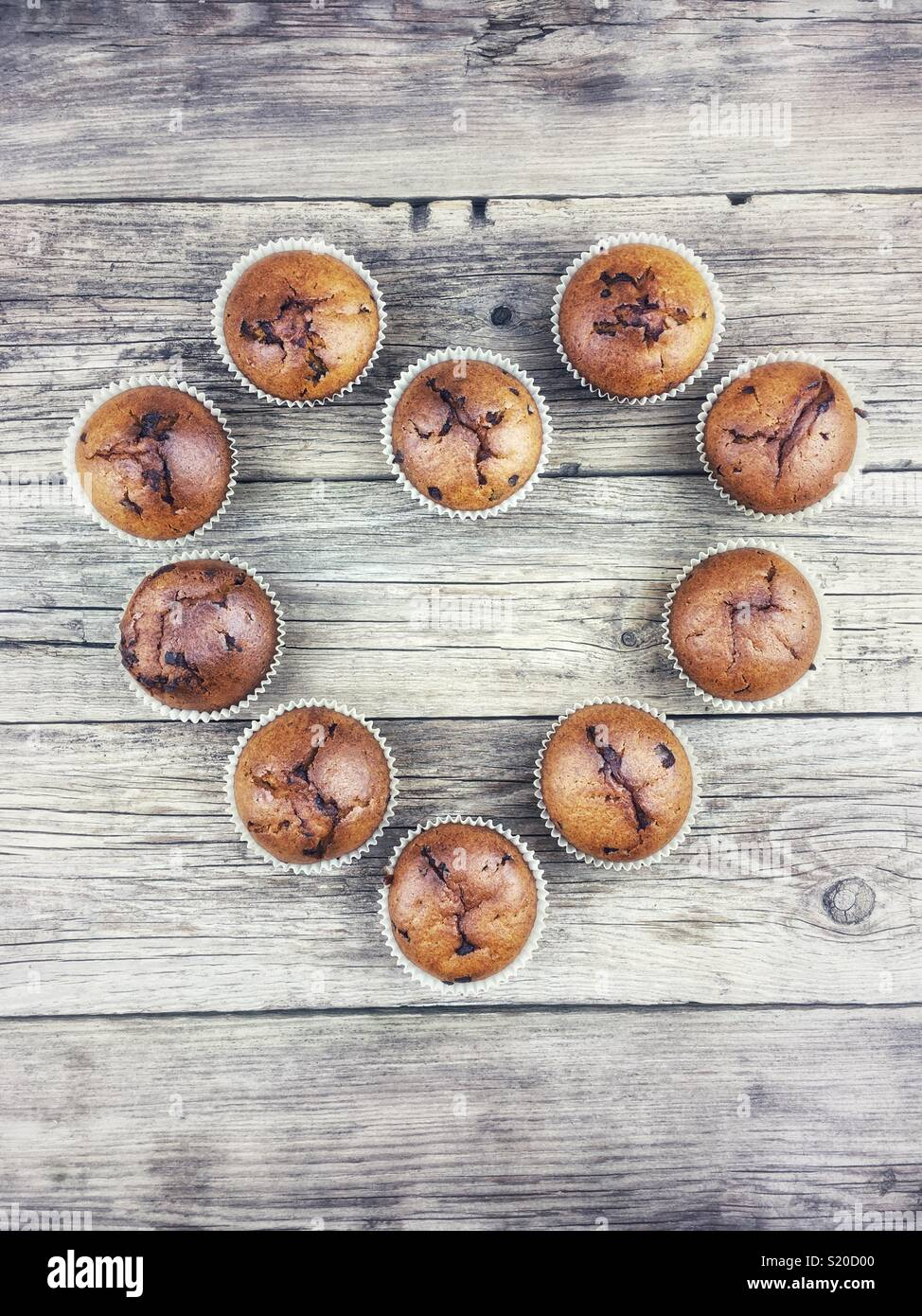 Top view of Chocolate muffins on a wooden table - Stock Image