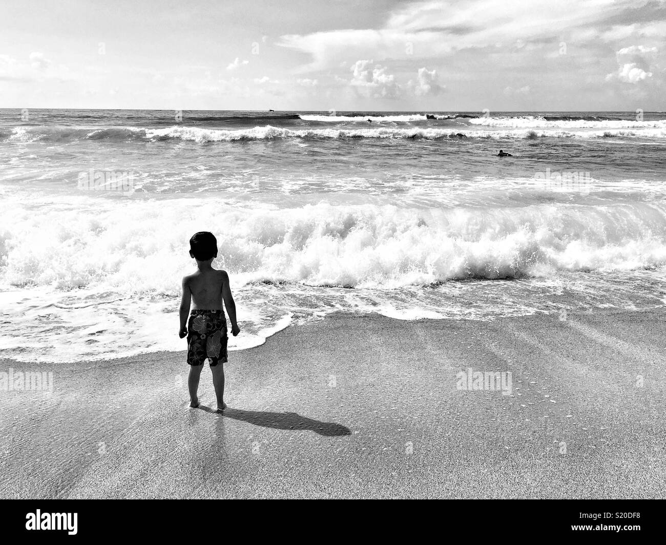 Boy meets wave Stock Photo