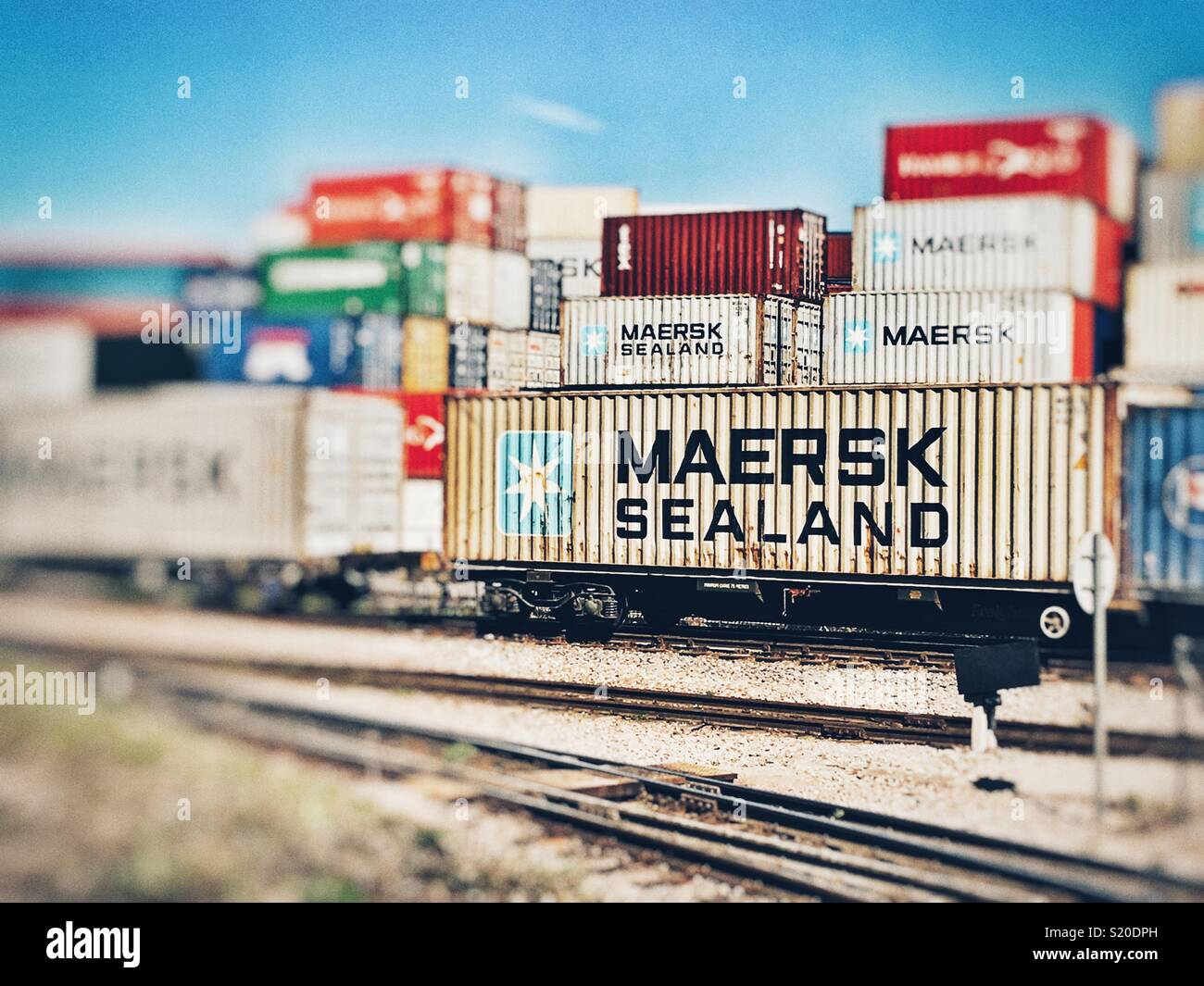 Maersk Sealand containers transported from the Port of Felixstowe by rail from the north terminal, Suffolk, England. - Stock Image