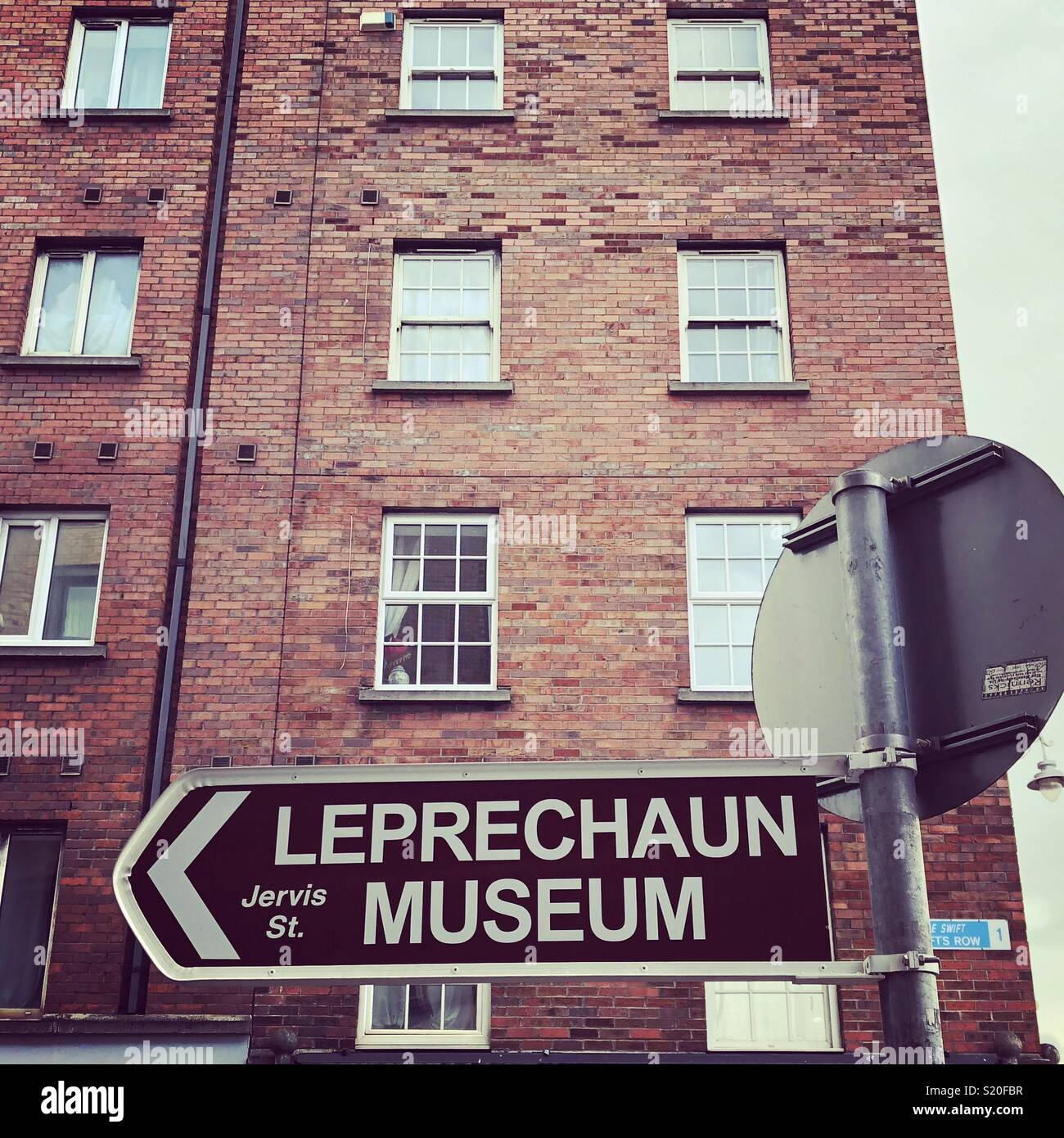 A sign pointing to the Leprechaun museum in Dublin, Ireland. - Stock Image
