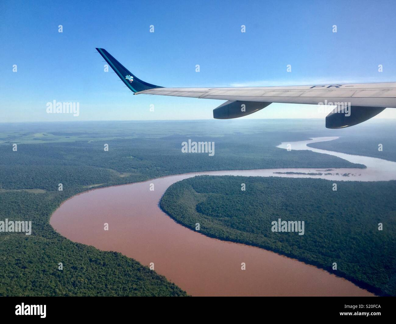Overflying Brazil's Rainforests and River - Stock Image
