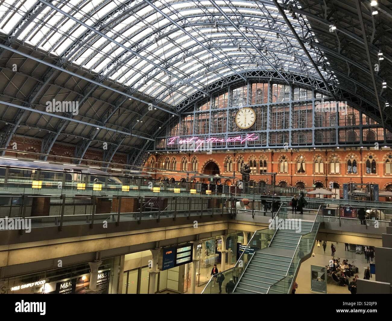 St Pancras International Railway station in London, with Tracy Emin installation next to the railway clock, first on display in April 2018 Stock Photo
