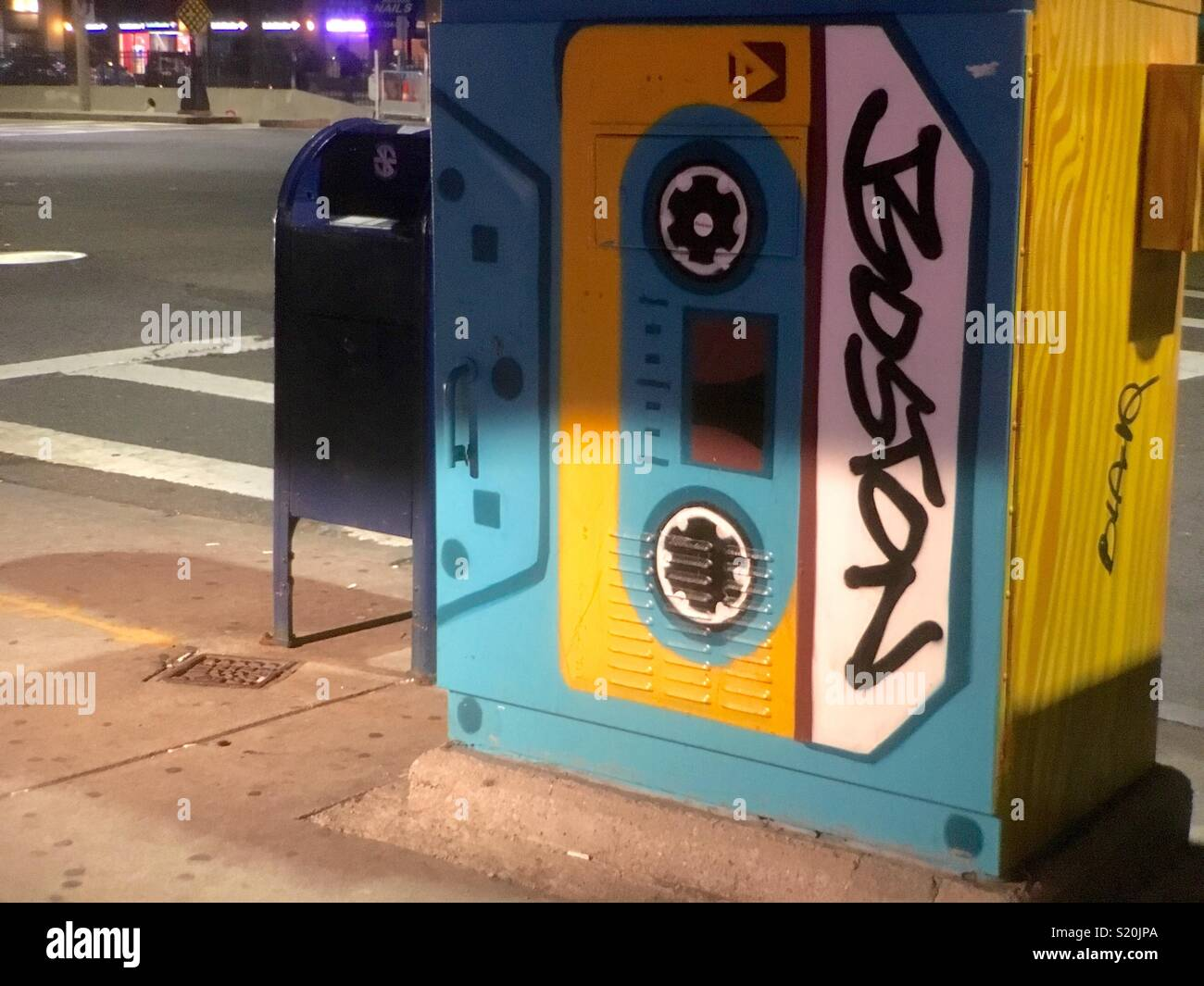 Boston utility box painted as a cassette tape in area frequented by college students and musicians - Stock Image