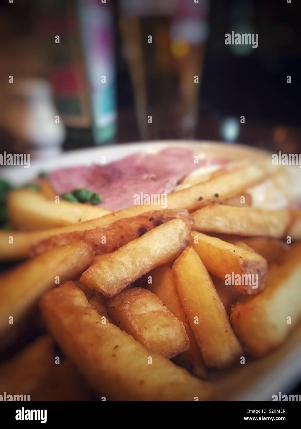 Good British pub grub ham egg and chips - Stock Image