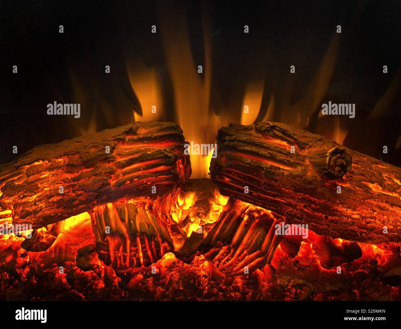Red Hot Flames And Burning Logs In A Faux Fireplace Heater Stock