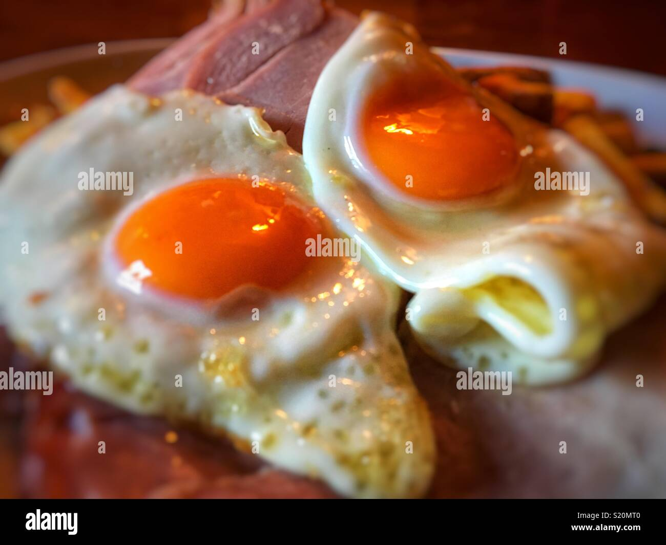 Pub grub ham egg and chips with two eggs - Stock Image