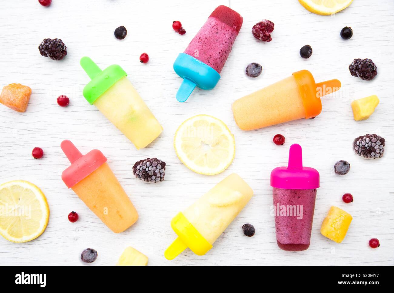 A flat lay food image of colourful fruit flavoured ice lollipops
