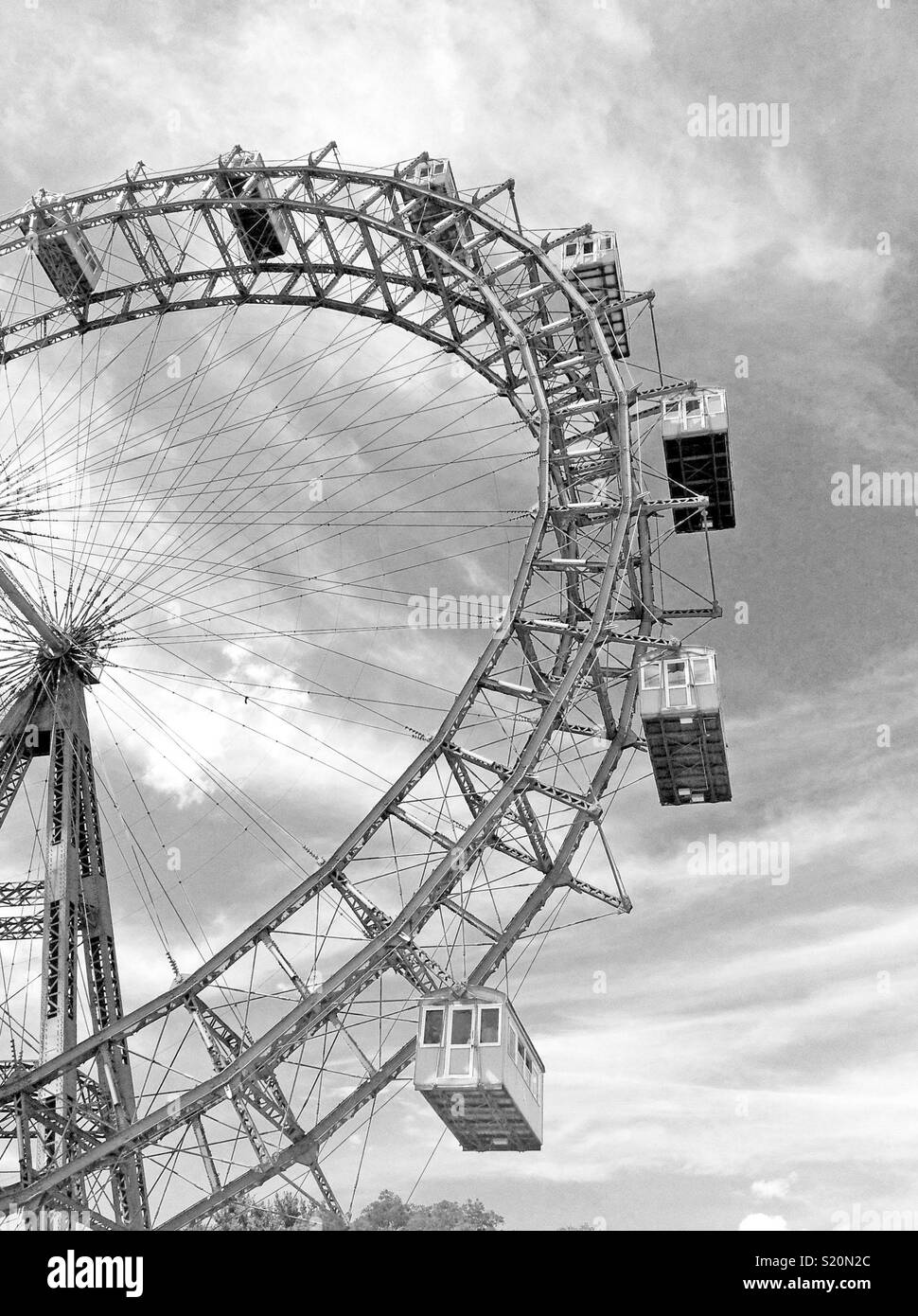 The Riesenrad Ferris wheel is an iconic ride at the Vienna amusement park - Stock Image