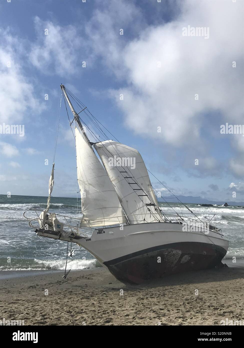 Sailboat runs aground in Pacifica, California - Stock Image