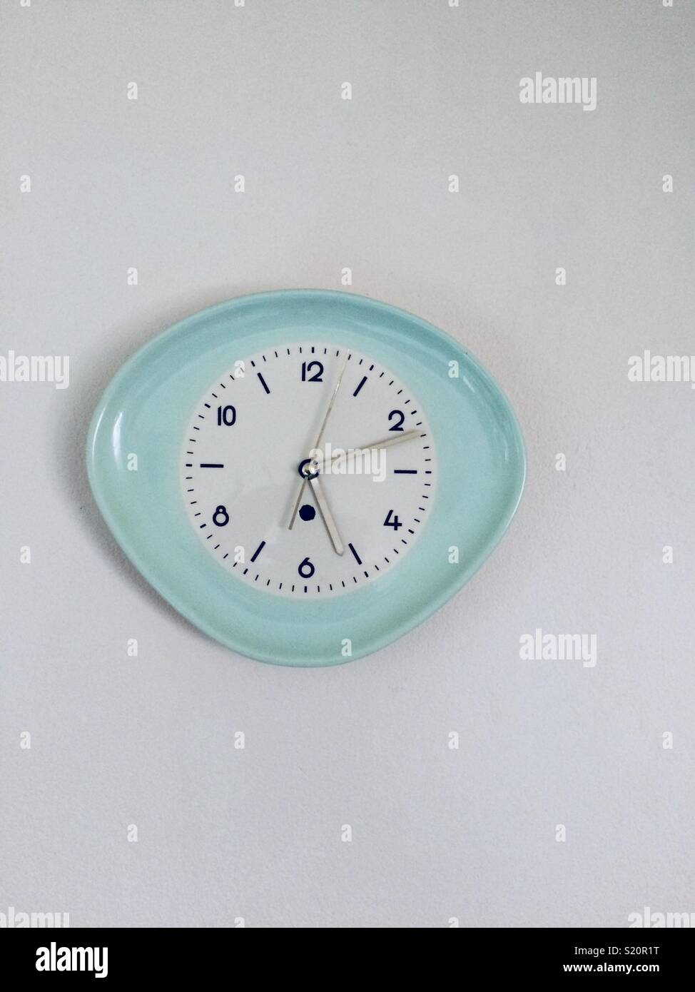 A vintage wall clock - Stock Image
