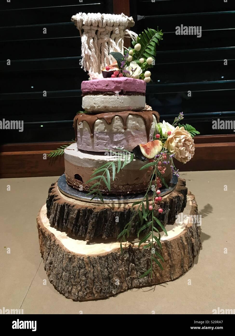 Raw vegan wedding cake with flowers and fruit Stock Photo