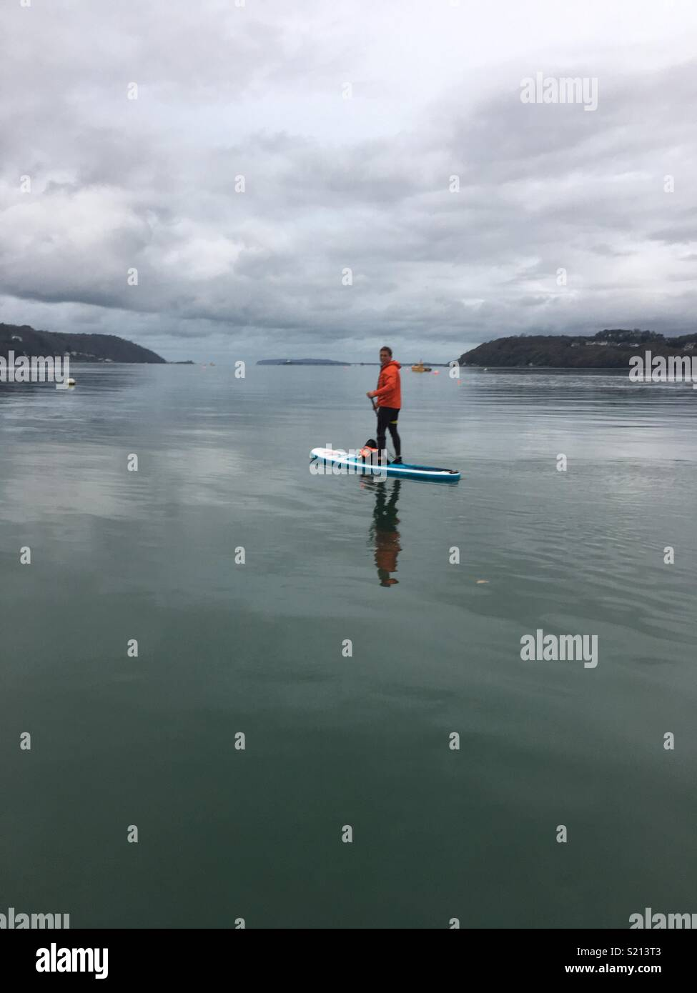 Paddle boarding on the Menai Straight Wales watersport - Stock Image