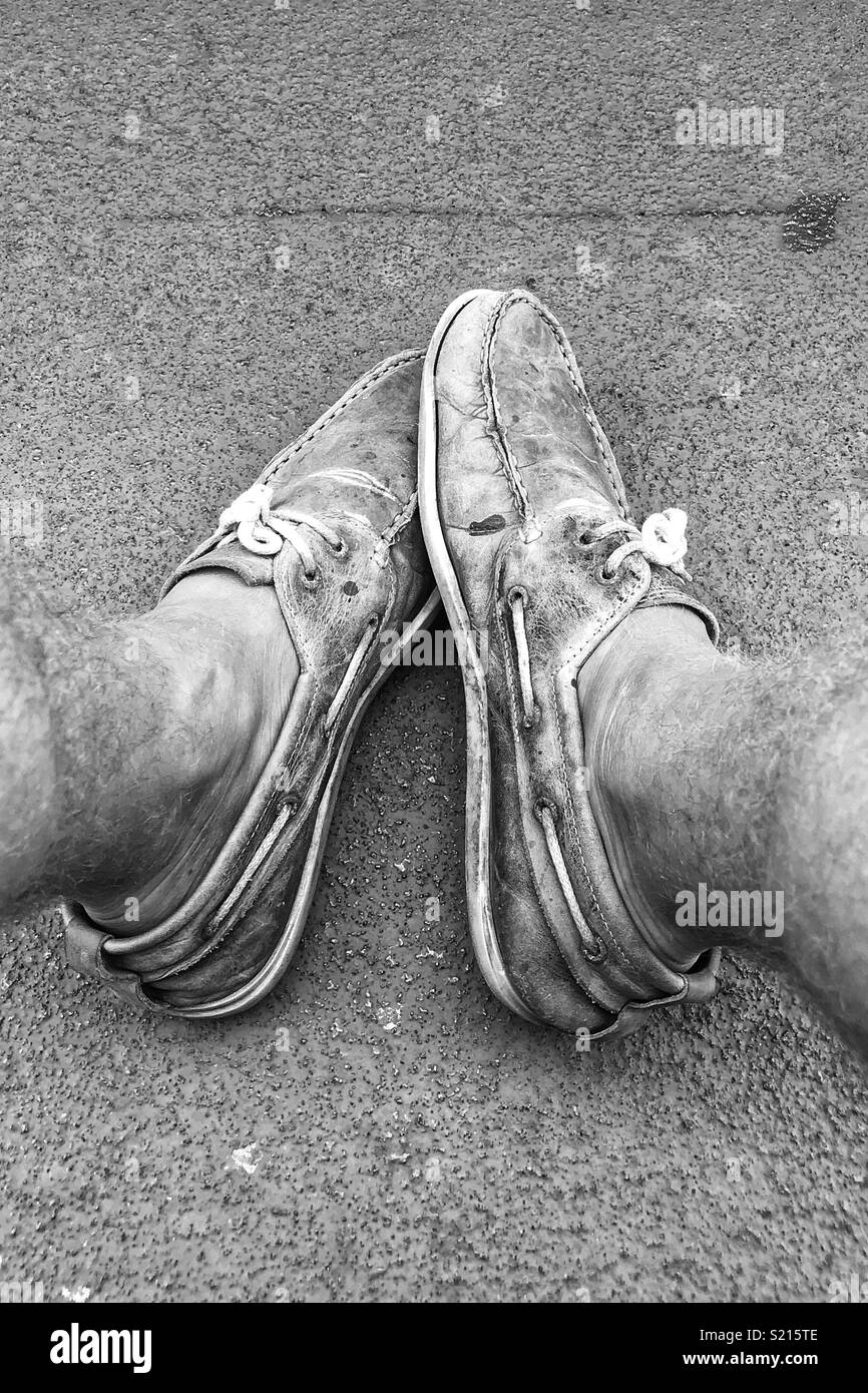 Tired feet. Worn shoes. - Stock Image