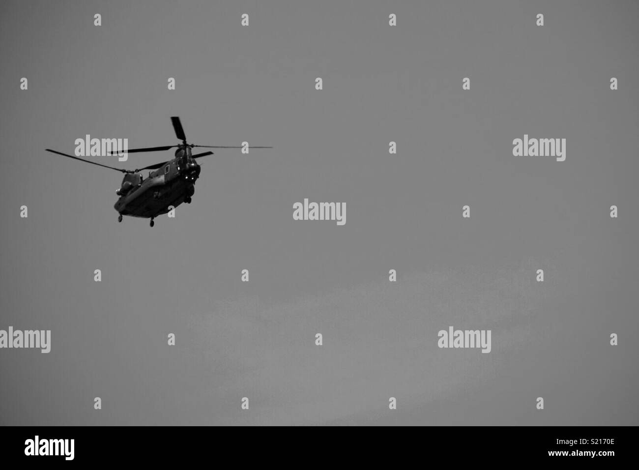 Army Helicopter flying over Gloucestershire - Stock Image