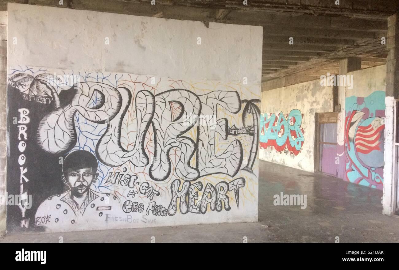 Graffiti in the abandoned Ducor Hotel in Monrovia, Liberia - Stock Image