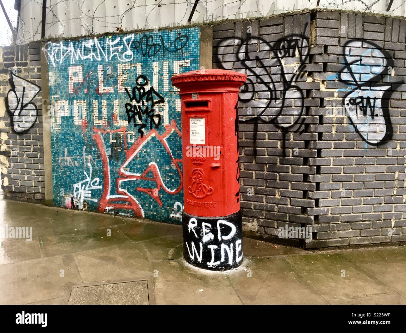 Traditional red post box located in hackney east london taken in march 2018 stock image