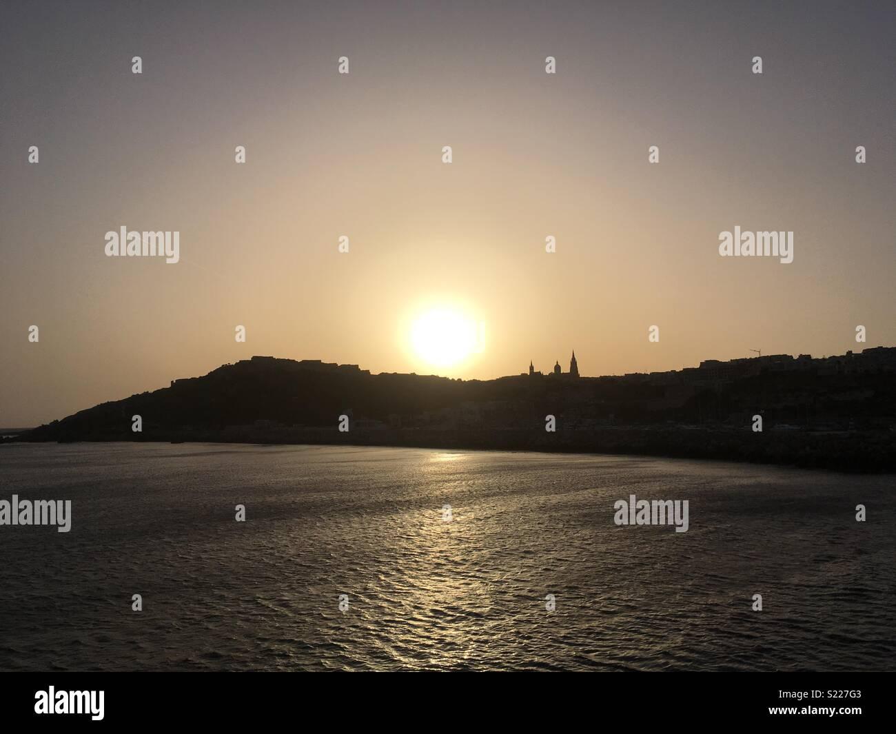 Sunset over Gozo - Stock Image