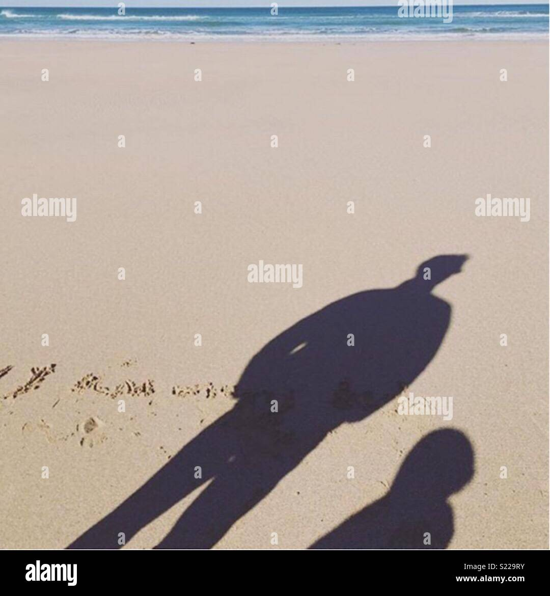 Beach shadows father and son - Stock Image