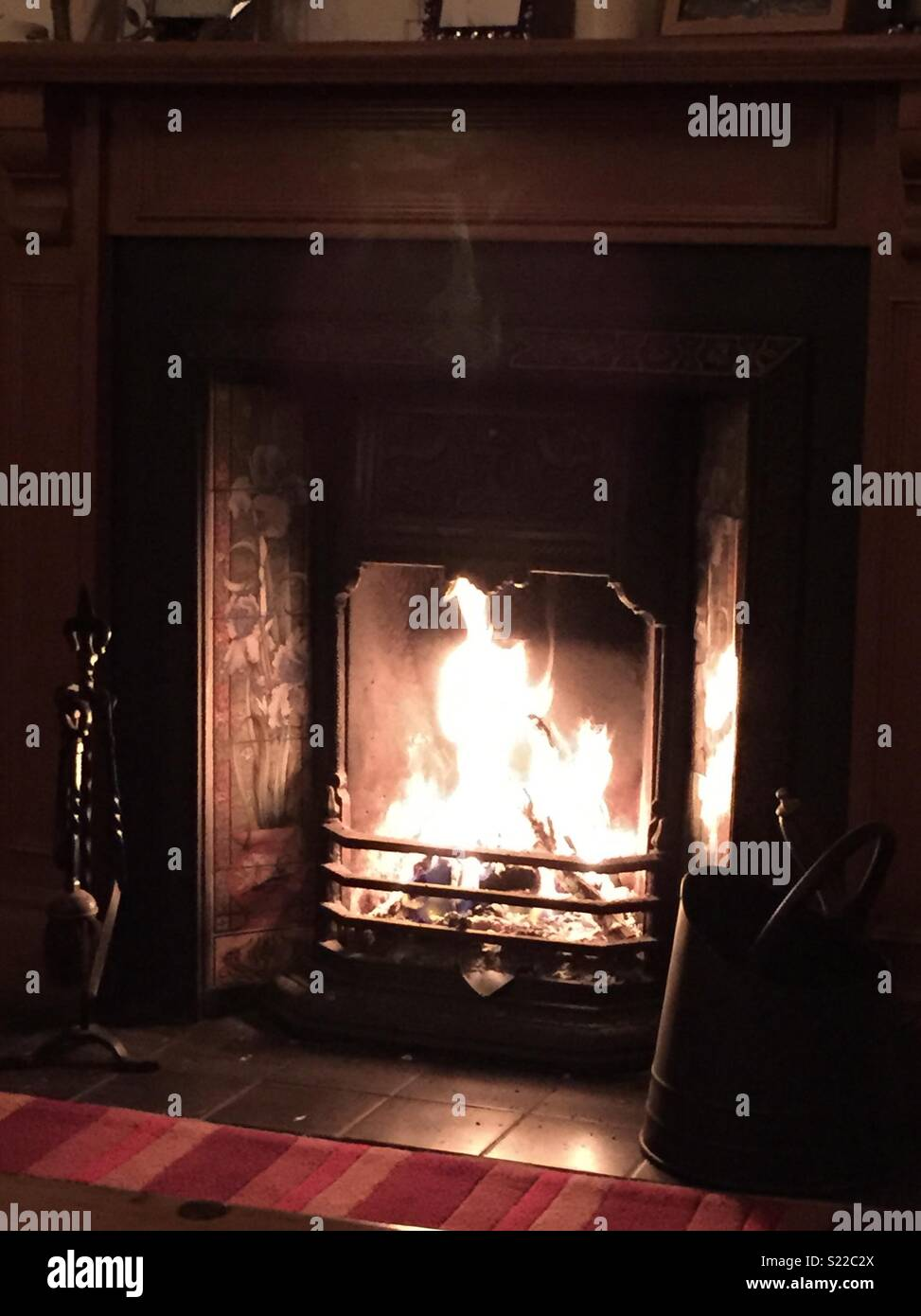 Hygge fireplace at home - Stock Image