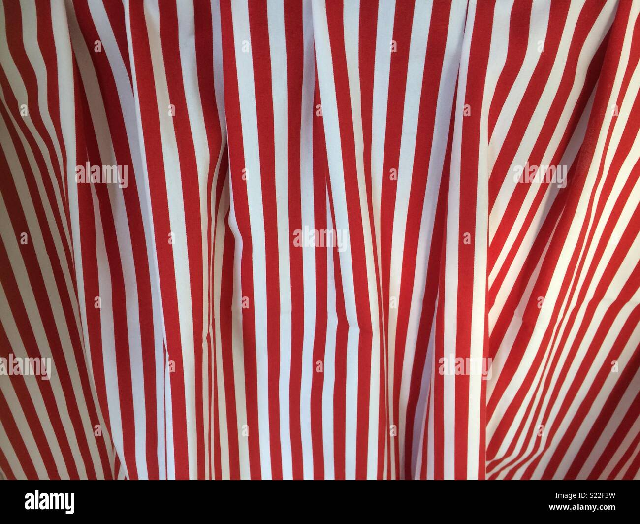 Red and white striped fabric - Stock Image
