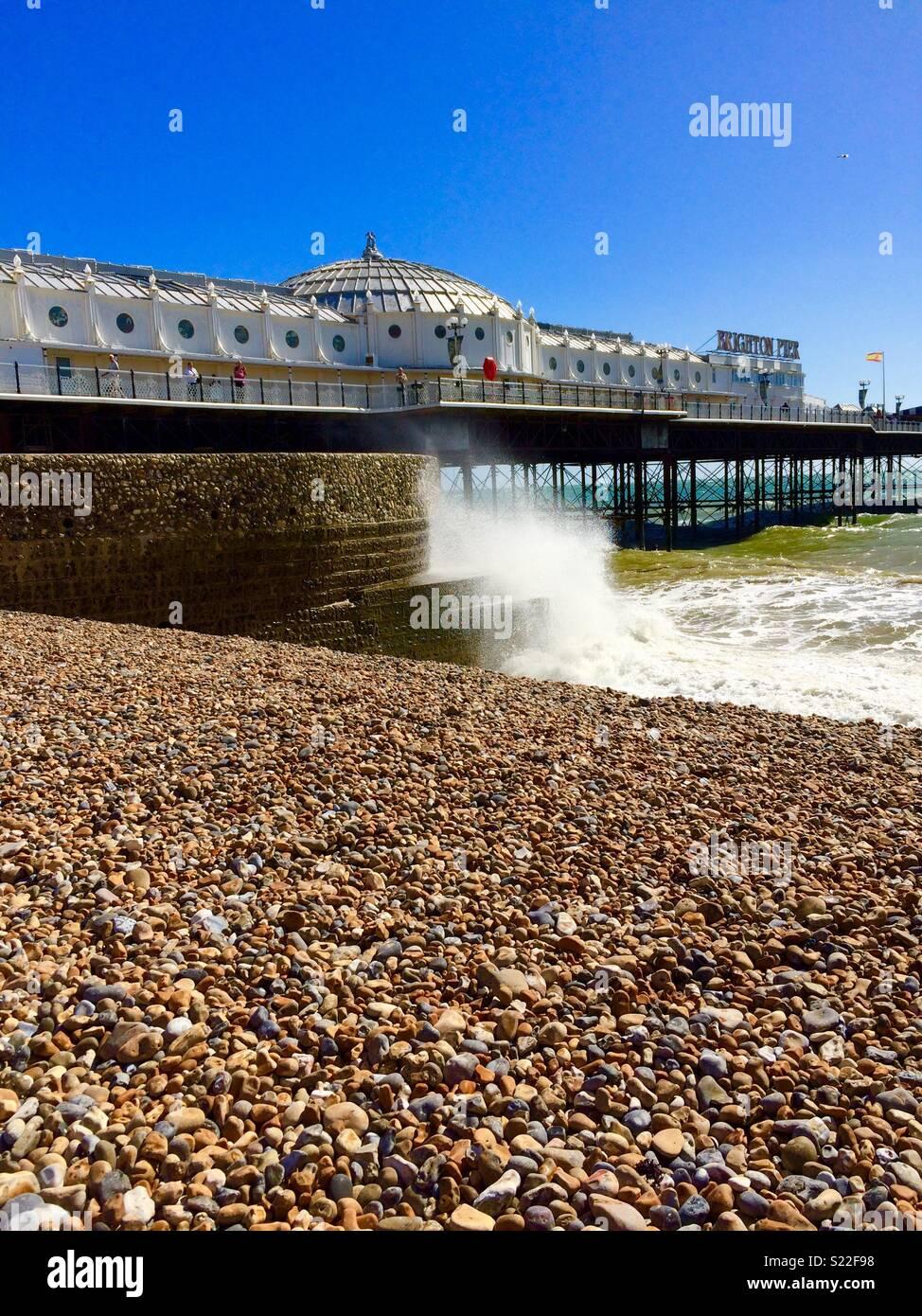 Splashes at Brighton Pier - Stock Image