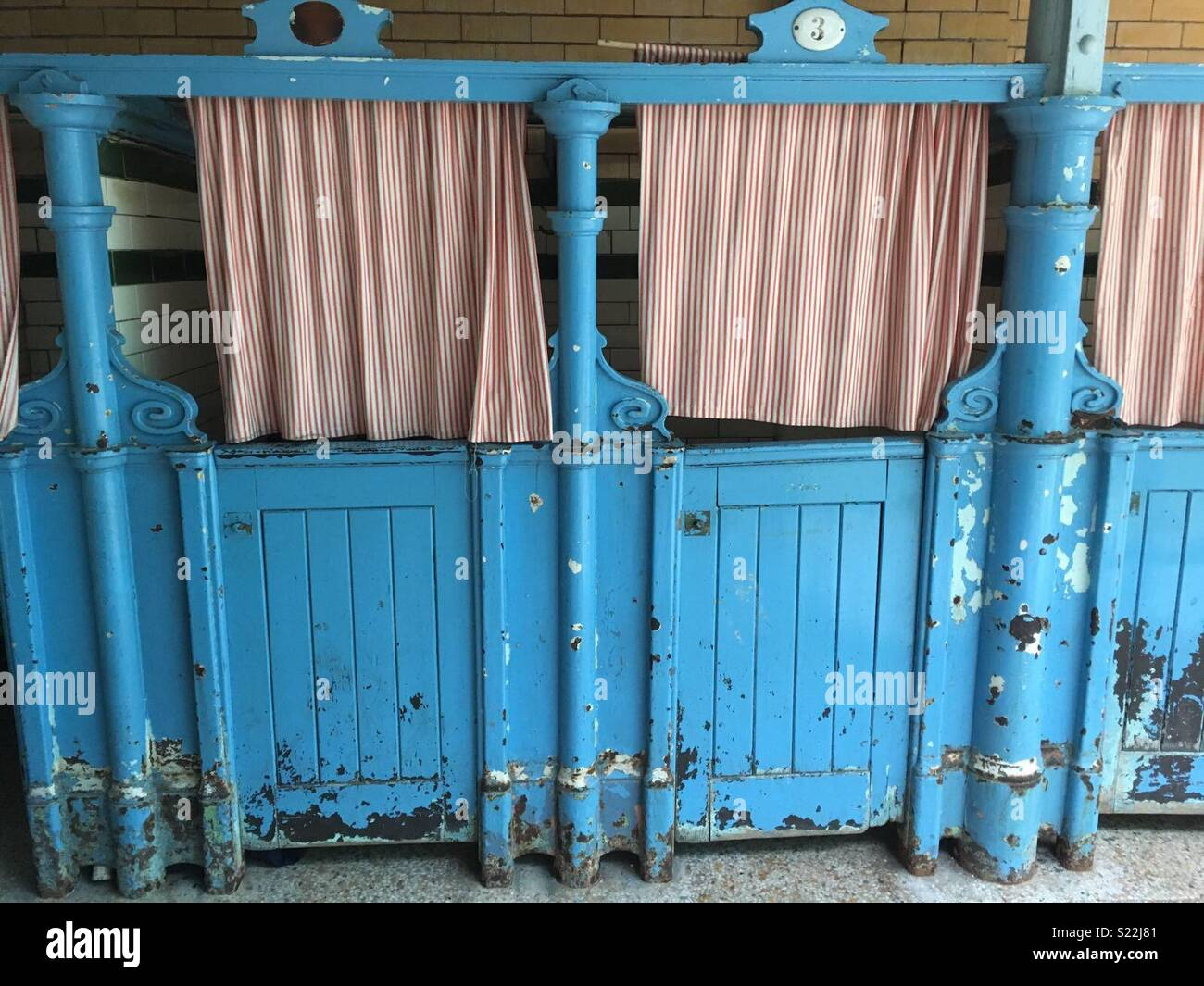 Victorian changing stalls at Victoria Baths in Manchester. - Stock Image