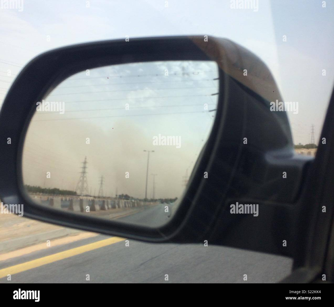 Sandstorm following me down the road - Stock Image