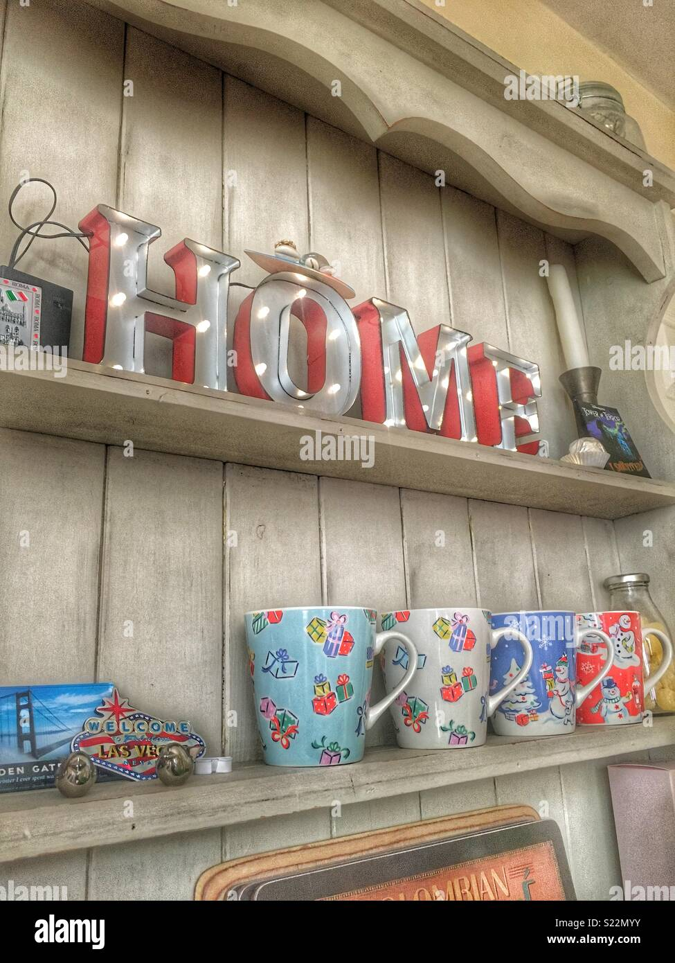 Home sign on a Welsh dresser with nik naks - Stock Image