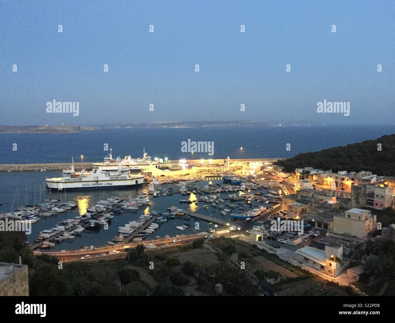 Gozo Harbour Dusk View - Stock Image