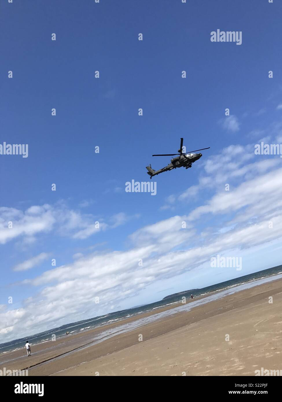 Helicopter over beach - Stock Image