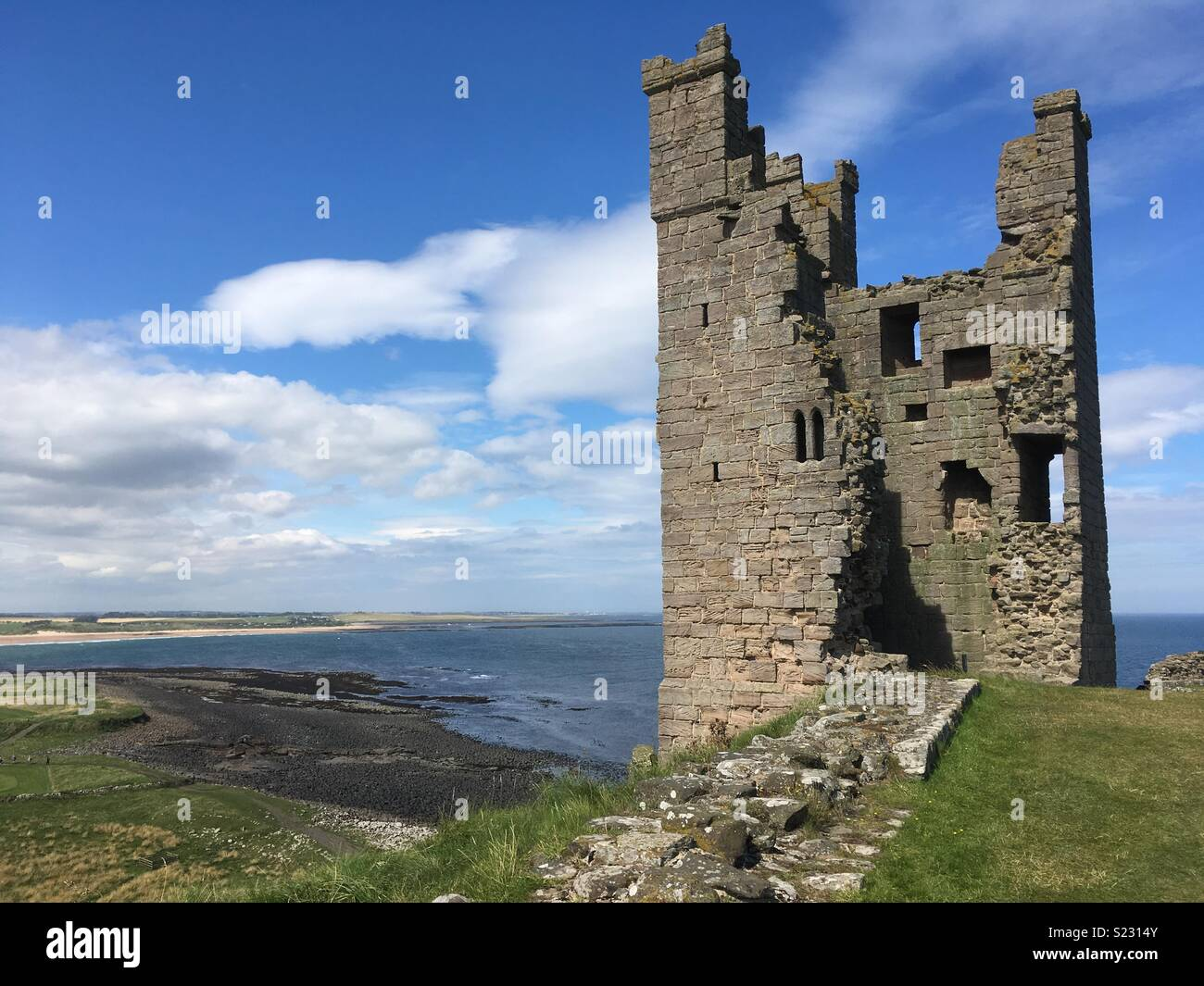 Dunstanburgh castle ruins on the northeast coast of England Stock Photo
