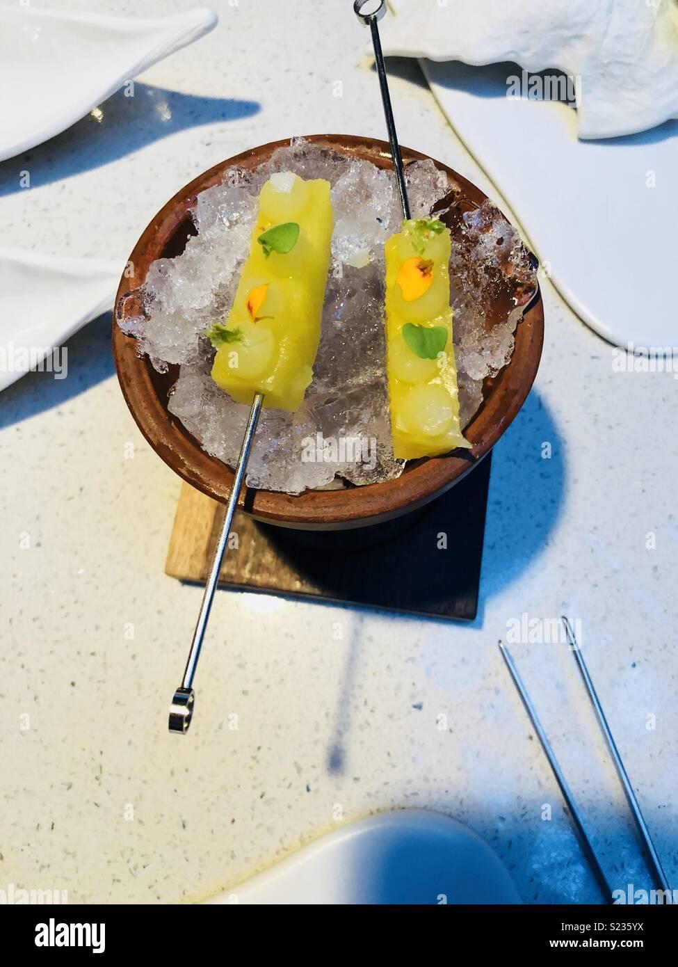Pineapple kebabs on Ice - Stock Image