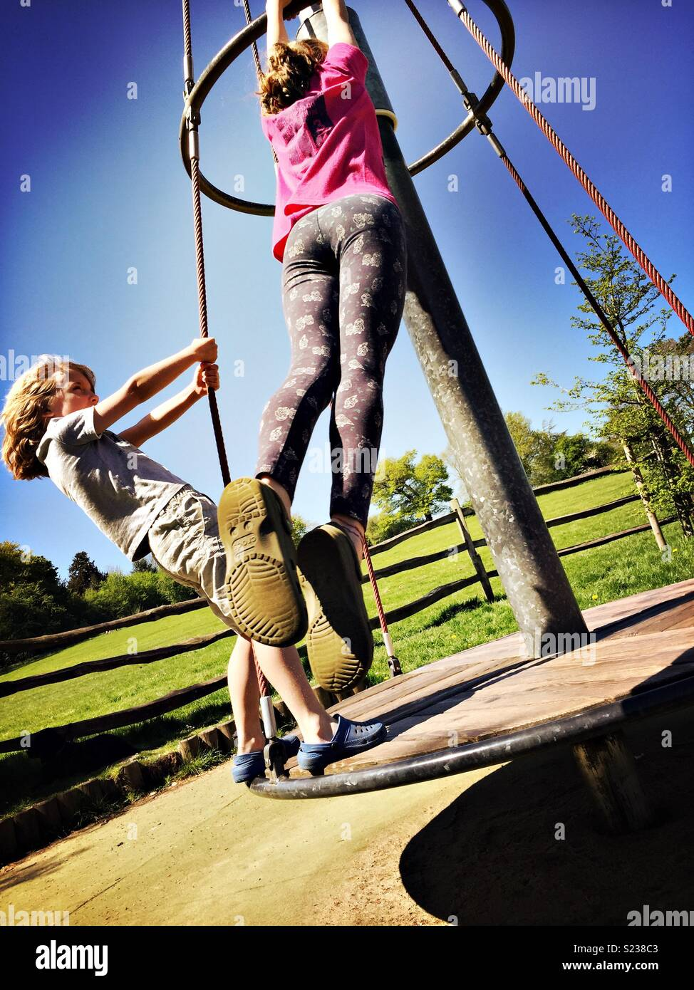 Kids playing in park. Action shot - Stock Image