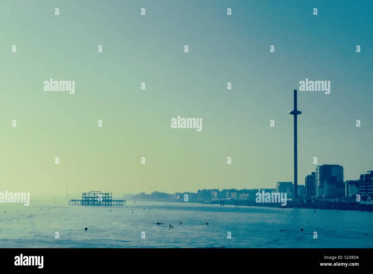 Brighton i360 and Old Brighton Pier blue sea and sky - Stock Image