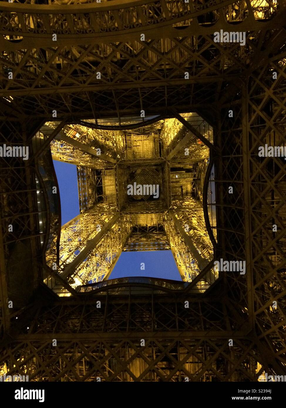 Standing underneath the Eiffel Tower - Stock Image