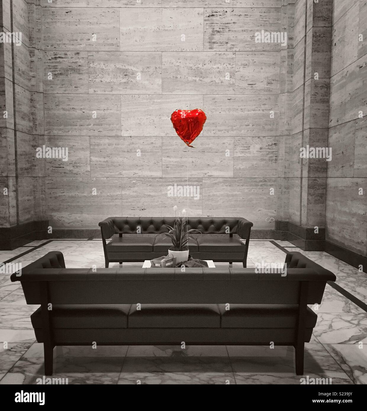 Red Balloon heart with desaturated colours. - Stock Image