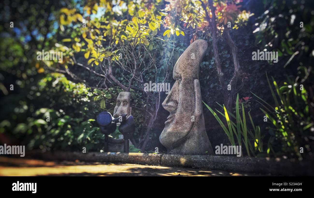 Easter Island Heads Talking In Garden
