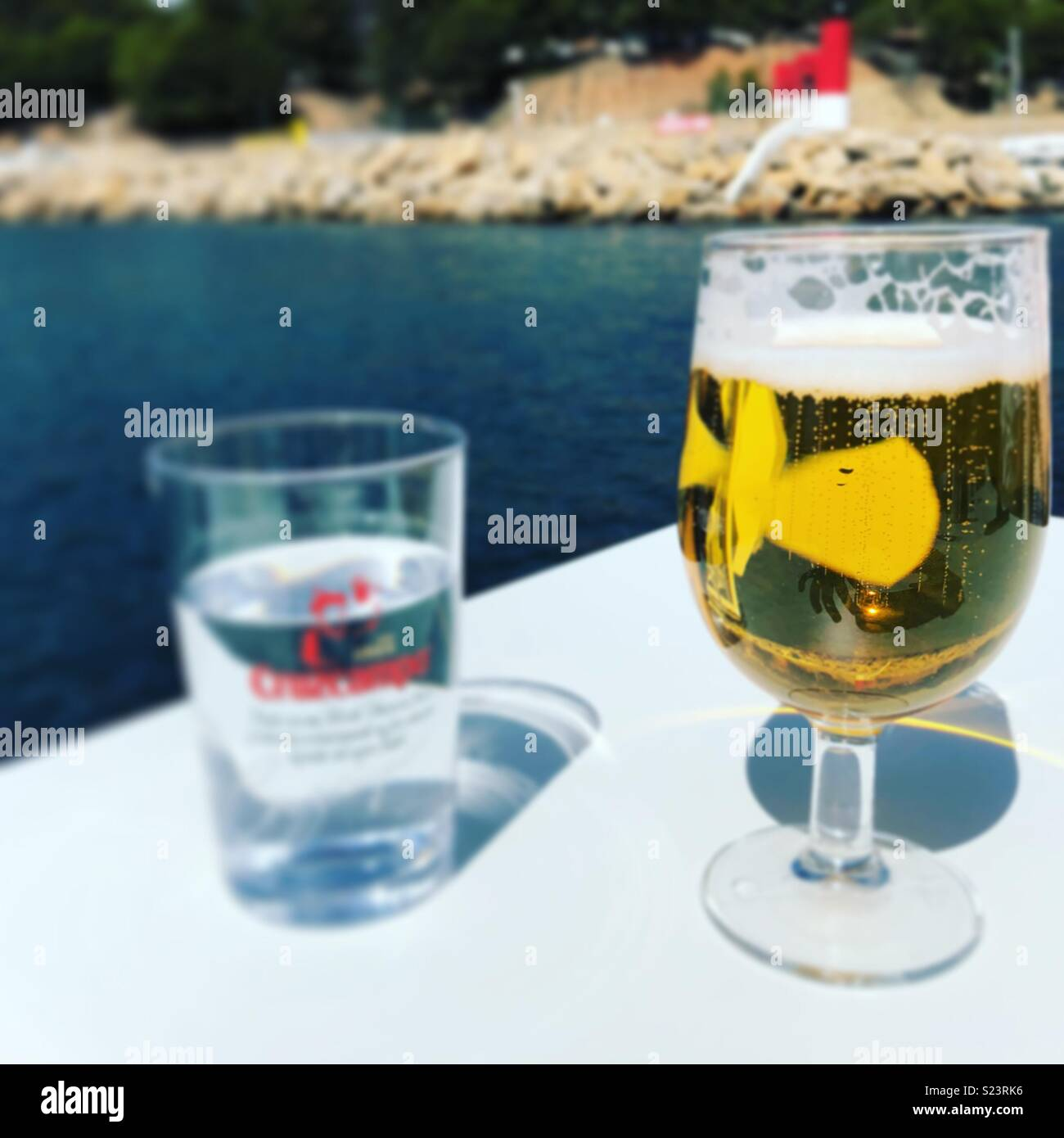 Cold beer on a hot day by the sea in Spain - Stock Image
